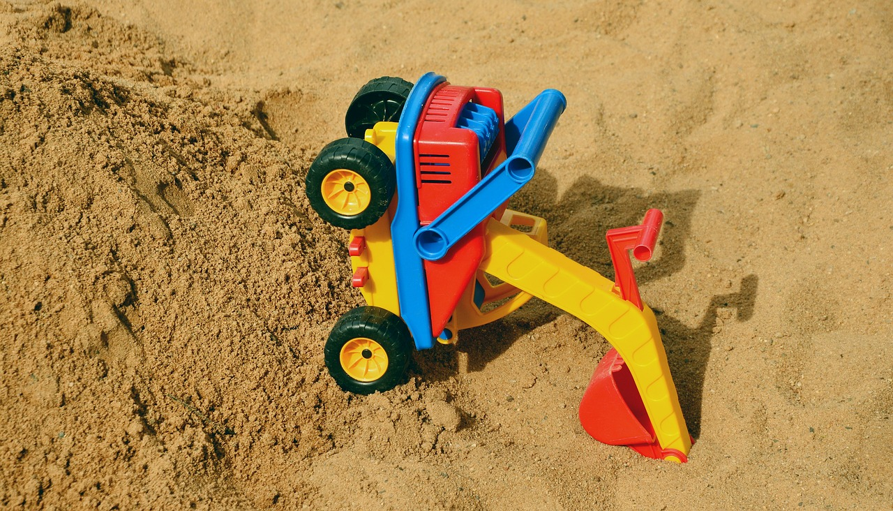 Digger in the sand